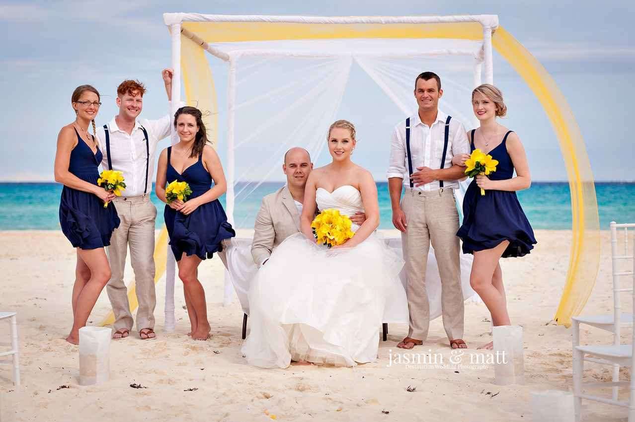 Entire wedding party on beach in Playa Del Carmen.