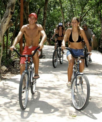 Several people on bikes during a jungle tour.