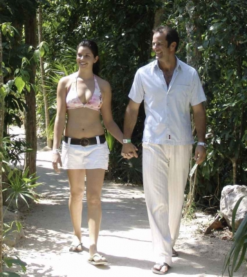 A man and a woman walking hand-in-hand during a jungle tour in Playa Del Carmen.