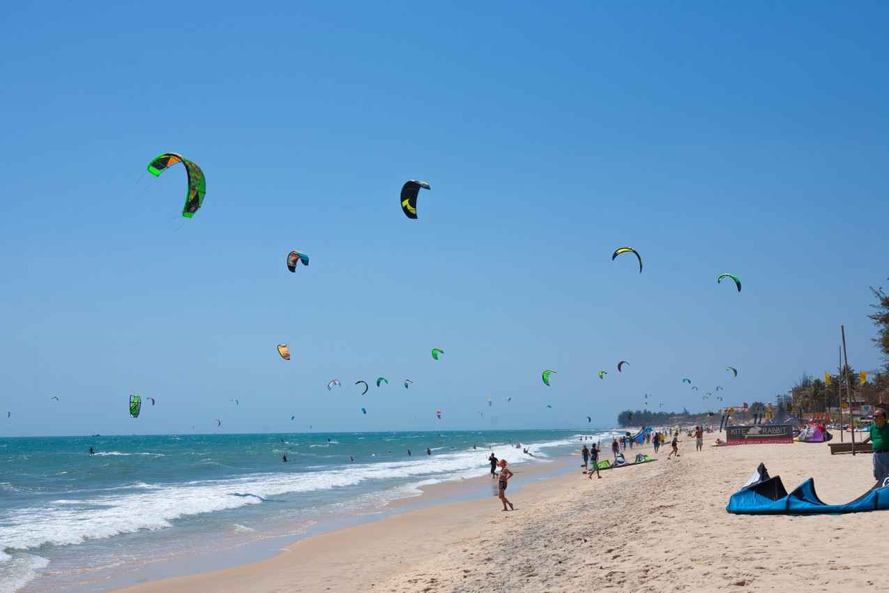 The southern beach of Playa Del Carmen crowded with kite boarders.
