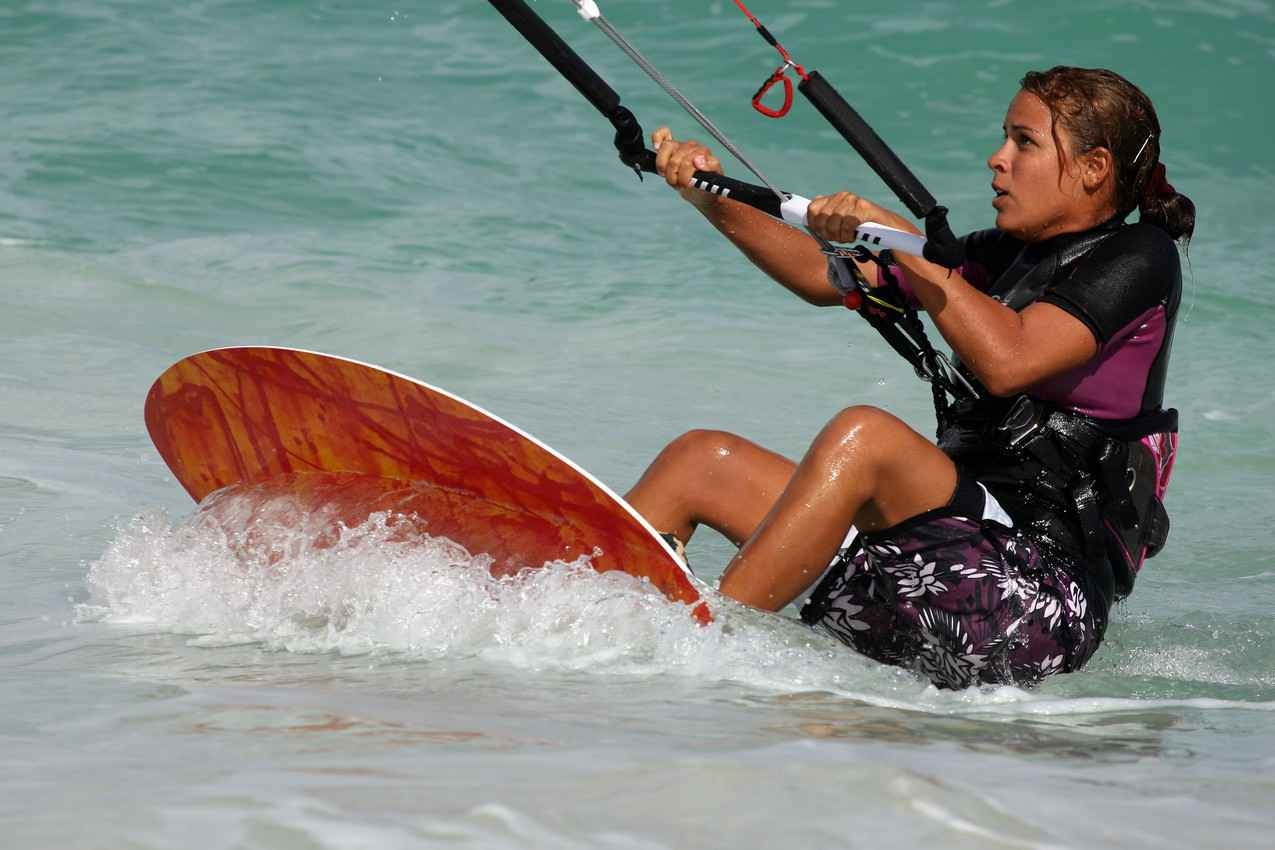 A gorgeous woman looking into the air while kite boarding near Playa Del Carmen.