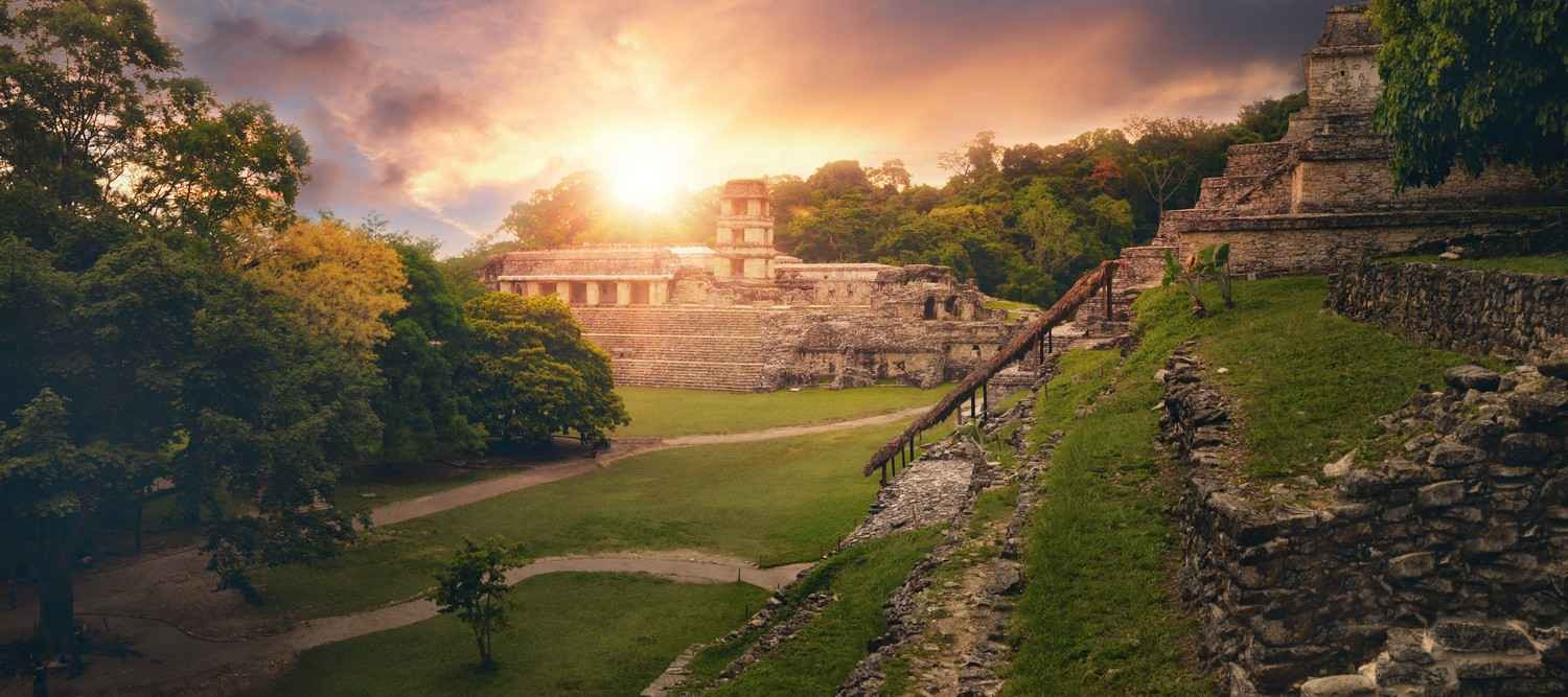 A Mayan archaeological site as seen at sunset.