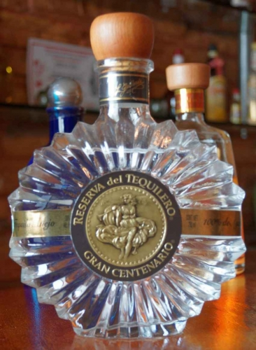 A bottle of Reserva Gran Centenario tequila.