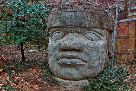 A large stone head statue.