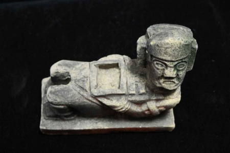 A very small Mayan statue found at a Mexico archaeology site.