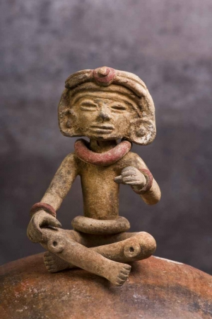 A miniature Mayan statue found at some ruins near Playa Del Carmen.