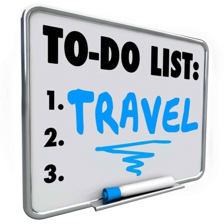A travel to do list on a whiteboard.