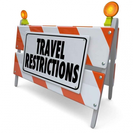Travel restrictions road sign.