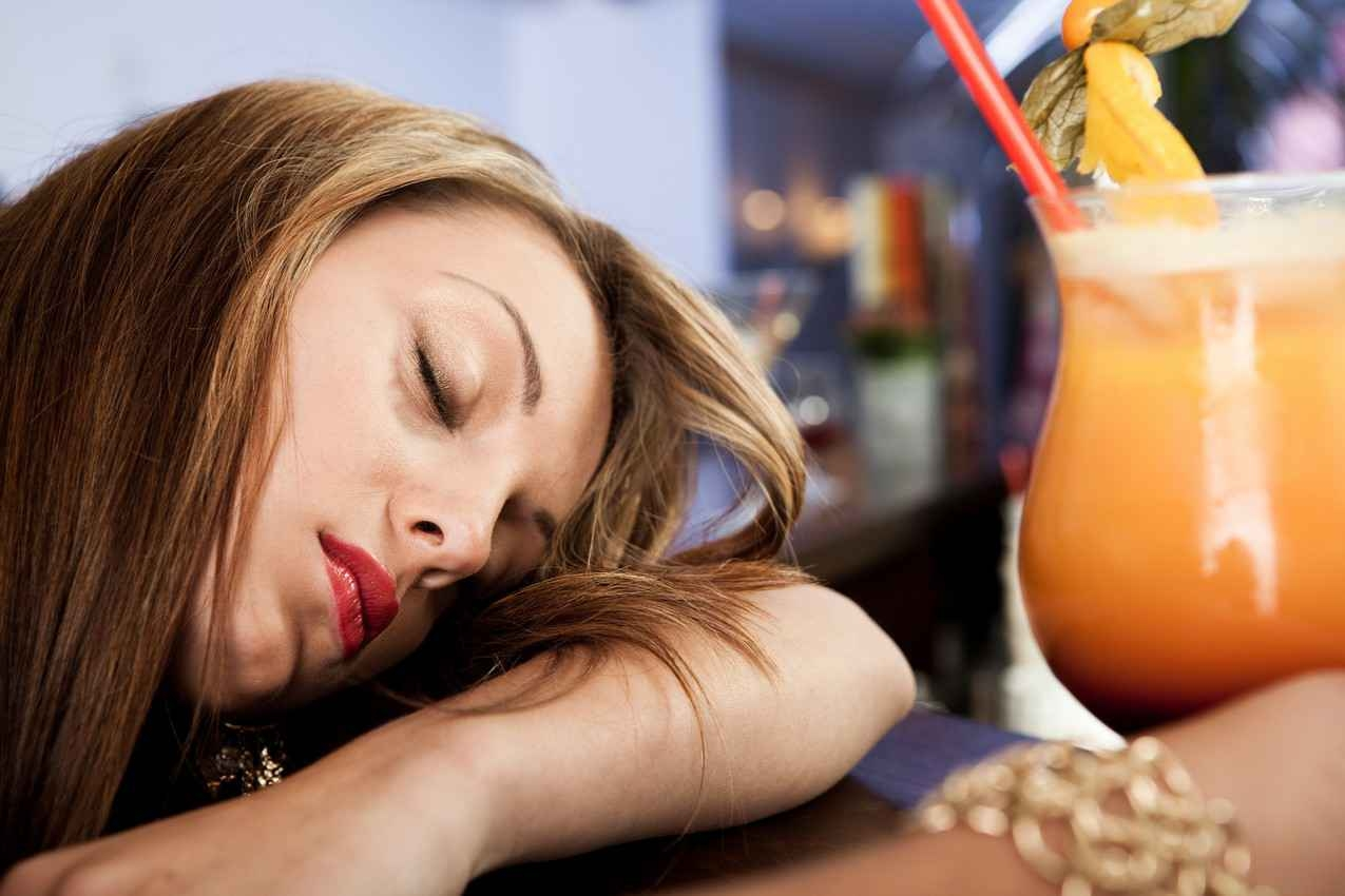 A woman at a bar who was knocked out from sleeping pills in her drink.