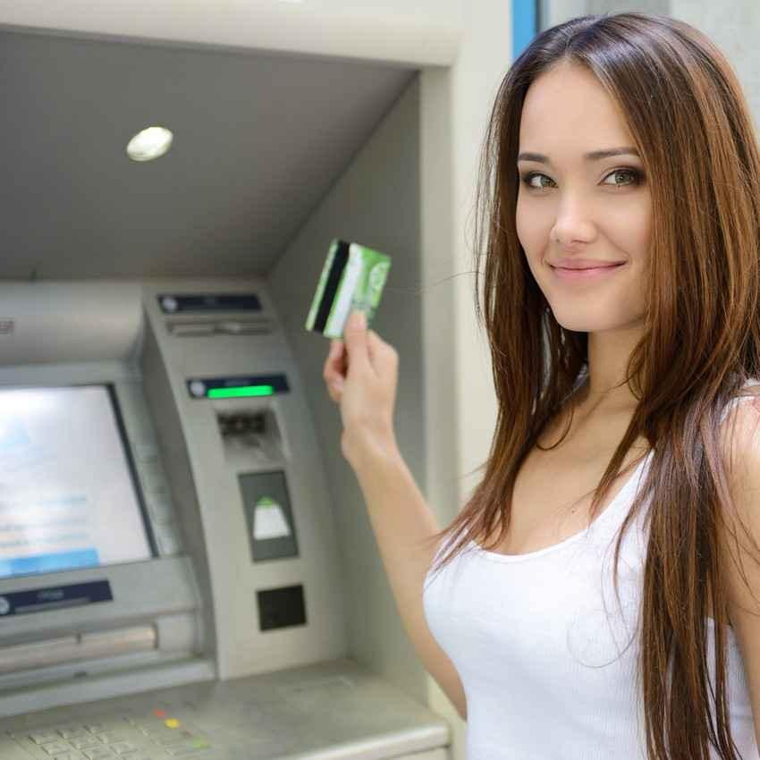A super hot woman at an ATM machine.