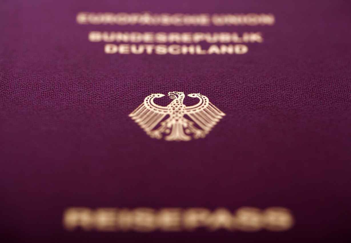 A zoomed in photograph of a German passport.