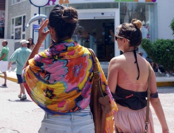 Two women who are shopping on fifth Avenue in Playa Del Carmen.