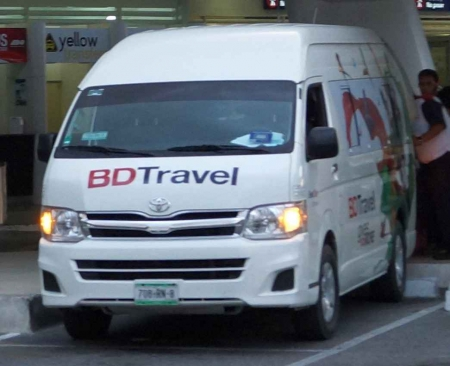A Playa Del Carmen travel transfer van at the Cancun international Airport.