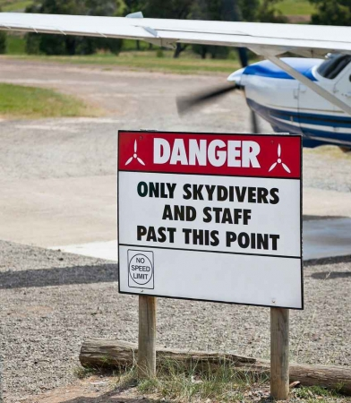 A sign at the airport in Playa Del Carmen that says, ONLY SKYDIVERS AND STAFF ALLOWED.