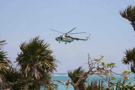 A large helicopter near a beach in Playa Del Carmen.