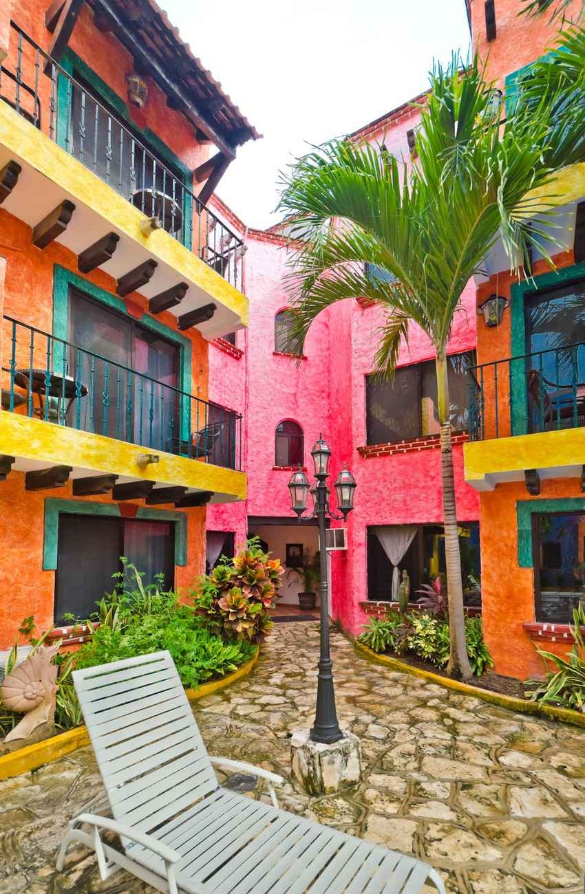 Several lollipop colored apartments for rent in Playa Del Carmen.
