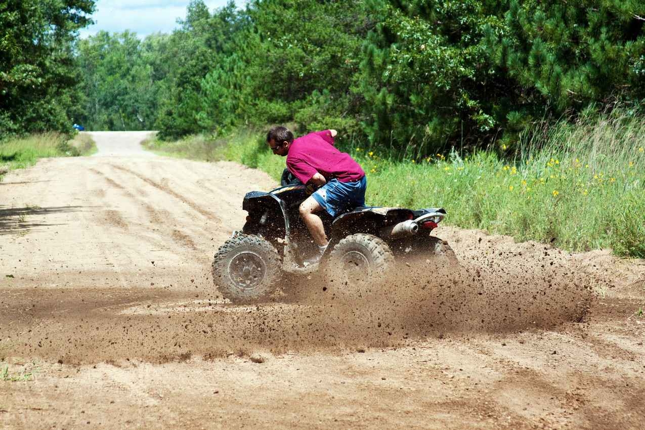 A man doing a doughnut during an ATV tour.