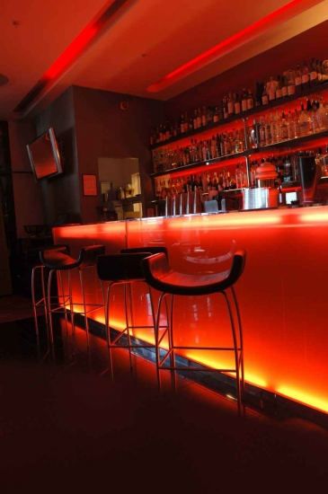A beautifully designed and neon lit bar.