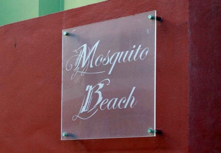A Mosquito Beach Club sign.