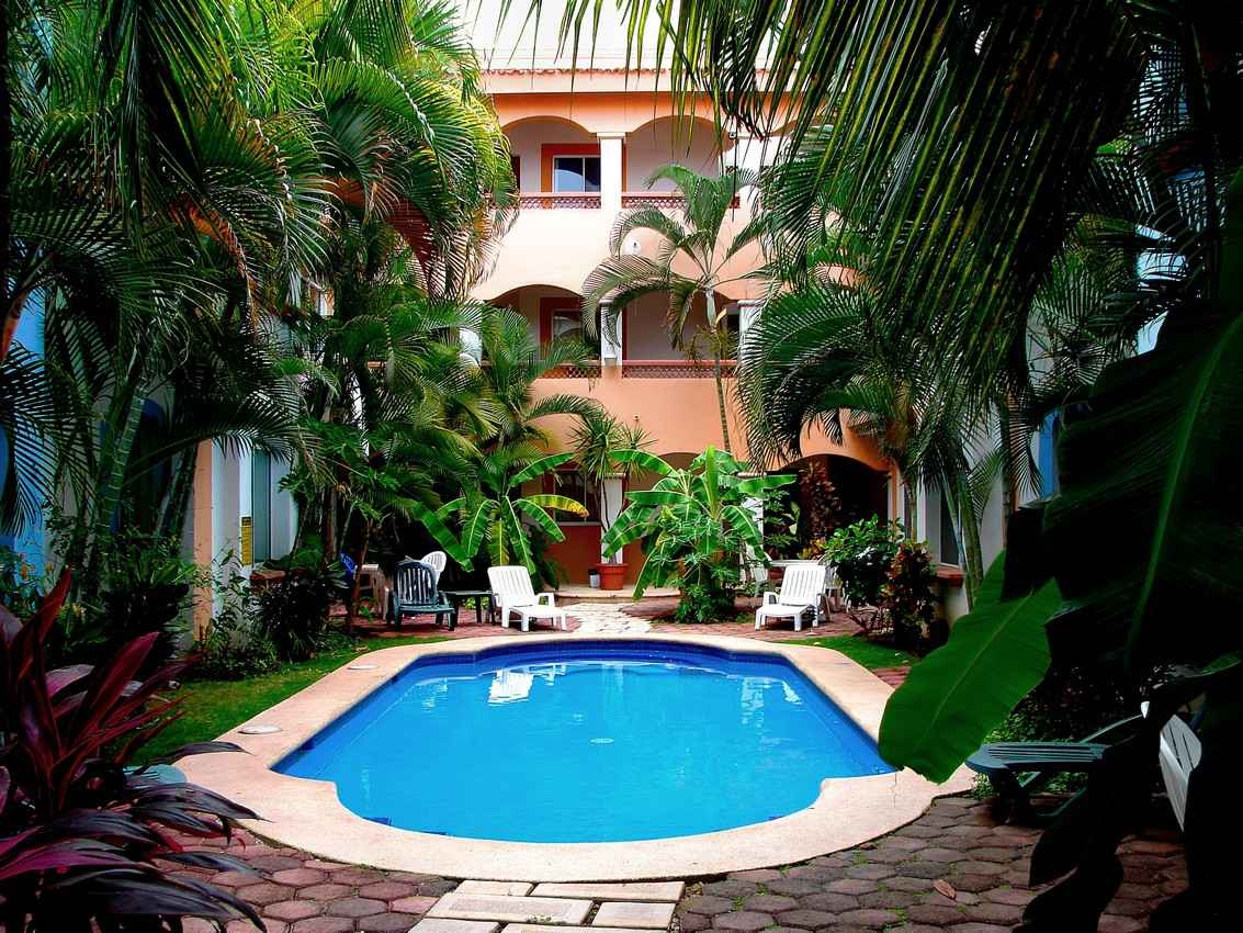Several condos for rent with a large swimming pool for residents.