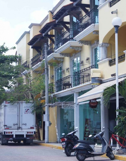 A large building with many condos for rent or sale.