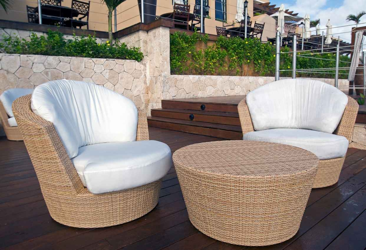Two extremely comfortable chairs on a condo balcony.