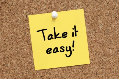 A Post-it note that says take it easy.