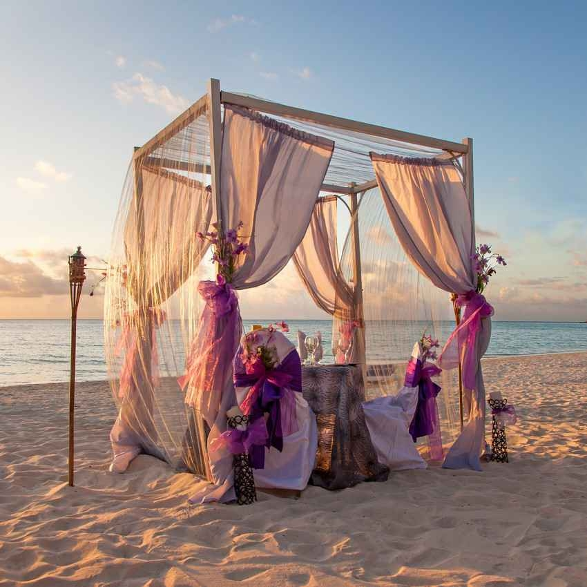 A poster bed style wedding ceremony structure.