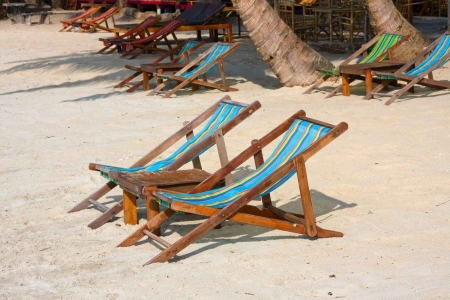 Several lounge chairs along the beach.