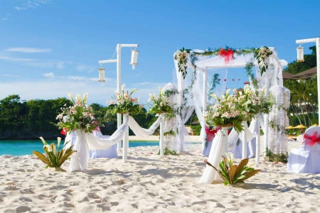The preparation that takes place for a tropical wedding ceremony.