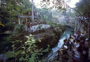 A group of men performing a Mayan ritual for tourists.