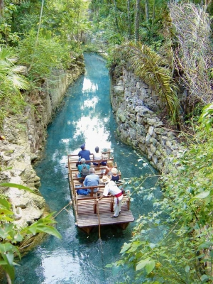 A group of tourists riding a boat down the river.