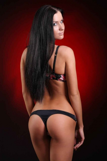 A super hot exotic dancer posing for a picture.