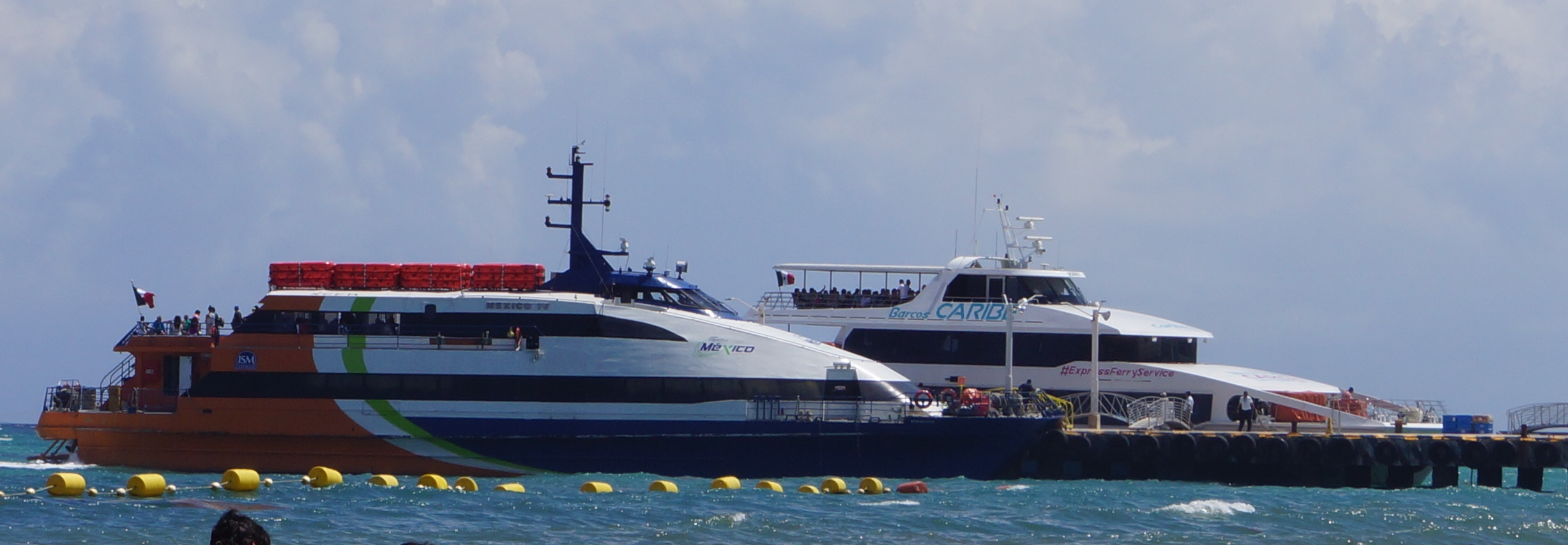 Two ferries parked at dock in Playa Del Carmen.