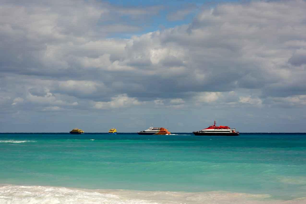 Several ferry boats crossing the Cozumel - Playa Del Carmen channel.