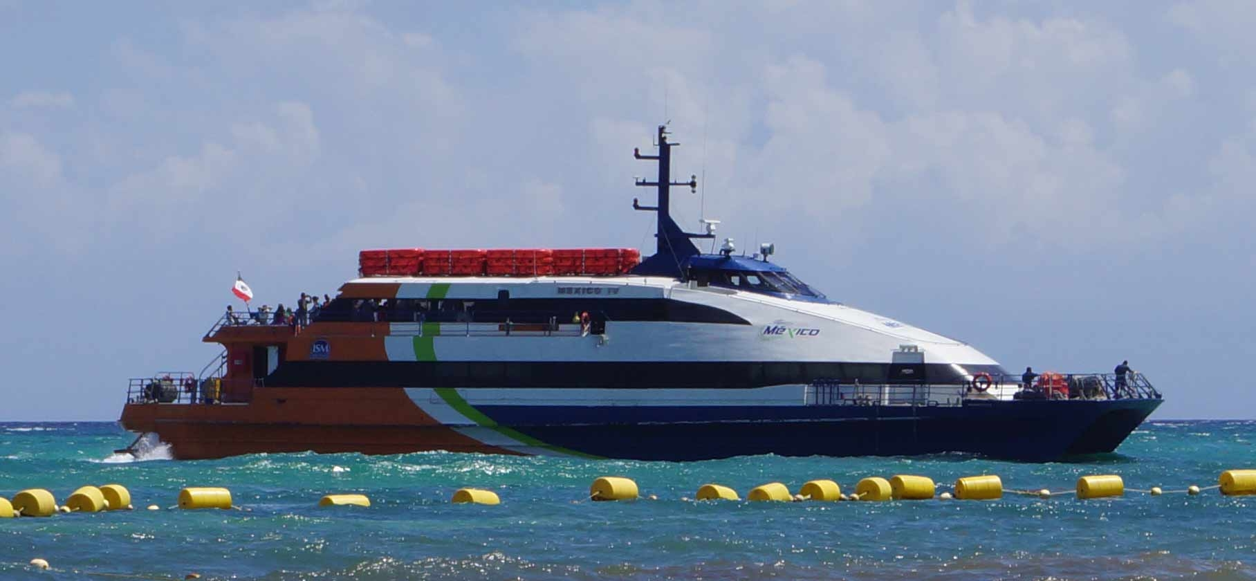 A ferry that is just getting ready to dock in Playa Del Carmen.