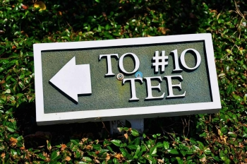 A sign showing directions to tee number 10.