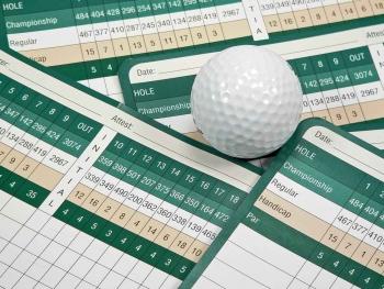 A stack of golf scorecards.