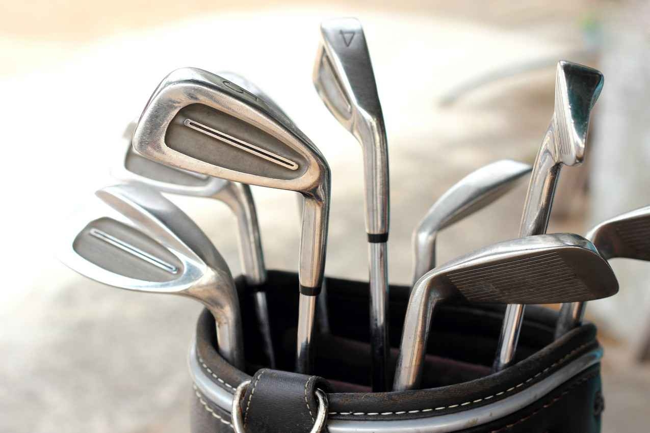 A set of golf clubs and golf bag.