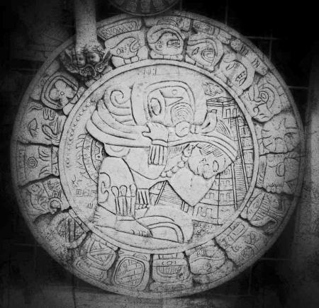 A black and white Mayan calendar.
