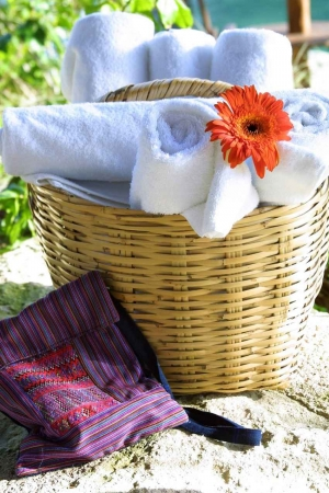 A basket with an abundance of towels for guests at a beach hotel in Playa Del Carmen.