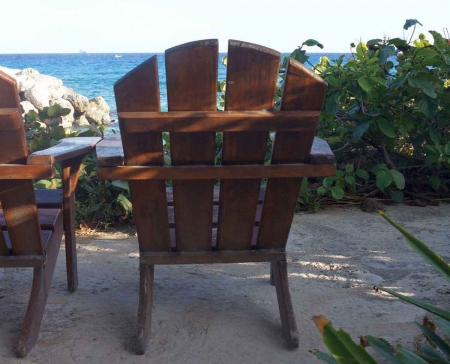 A wooden chair at a hotel near the beach.