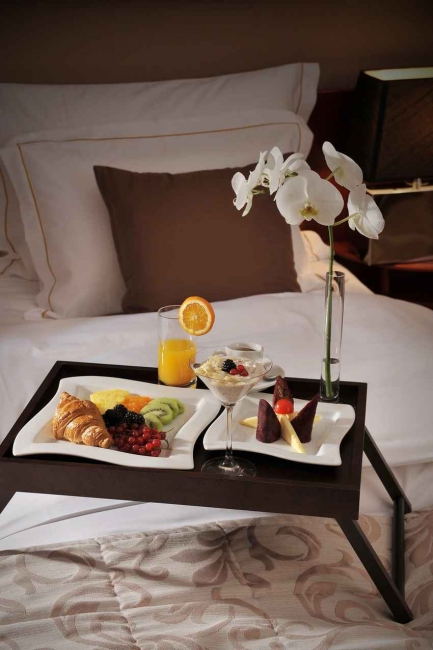 Room service in bed offered at an expensive hotel.