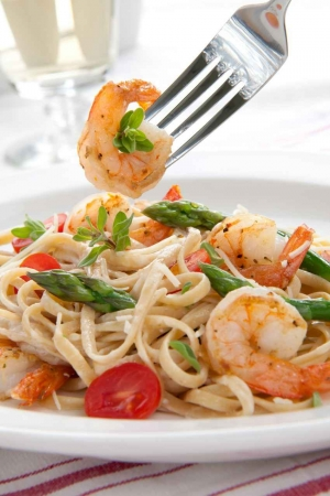 Shrimp fettuccine with asparagus and tomatoes.
