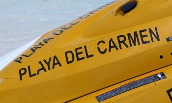 jet-ski-on-beach-labeled-with-playa-del-carmen