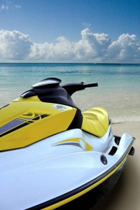 A jet ski on the beach with a label that says Playa Del Carmen.