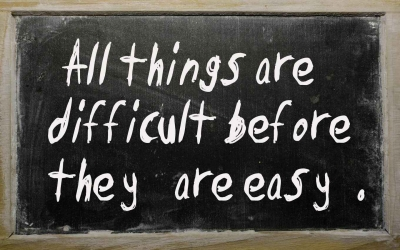 A chalkboard that says, all things are difficult before they are easy.