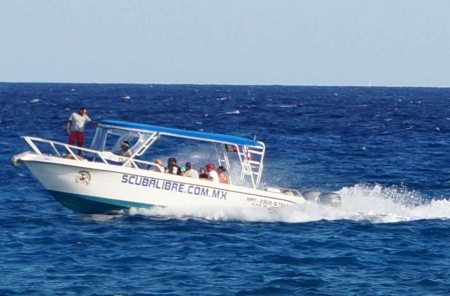 A scuba diving boat near the Playa Del Carmen shoreline.