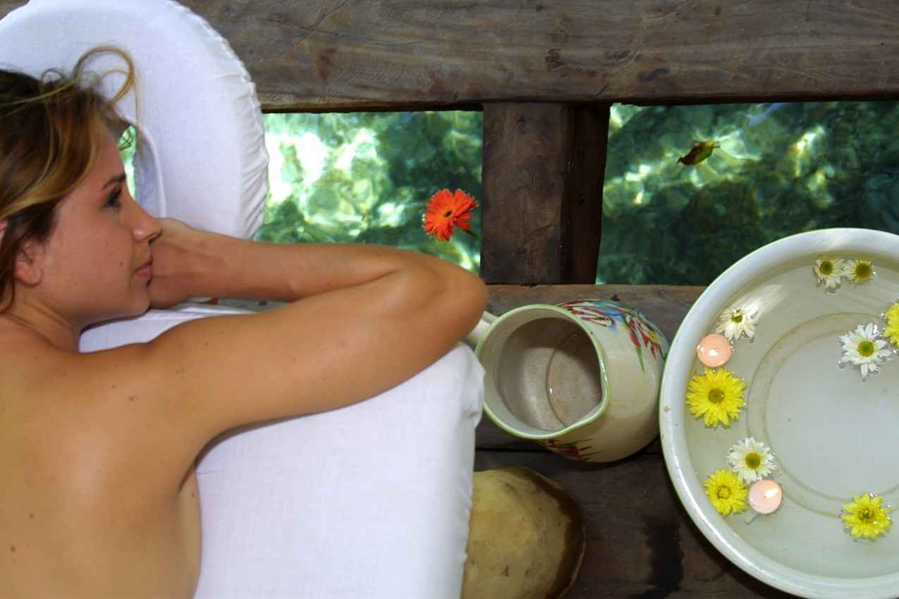 A woman waiting for a massage in a forest themed spa.