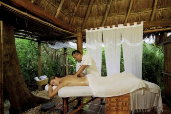 A woman receiving a natural rain forest-inspired massage near Playa Del Carmen.